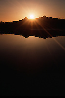 Sunset reflected in Crater Lake. Crater Lake National Park, Oregon.