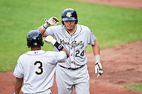 Kane County Cougars catcher Jose Queliz (24) is congratulated by Robelys Reyes (3) after hitting a home run during the first game of a doubleheader against the Cedar Rapids Kernels on May 10, 2016 at Perfect Game Field in Cedar Rapids, Iowa.  Kane County defeated Cedar Rapids 2-0.  (Mike Janes/Four Seam Images)