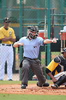 Umpire Junior Valentine strike three call during an Instructional League game between the Philadelphia Phillies and Pittsburgh Pirates at Pirate City on October 11, 2011 in Bradenton, Florida.  (Mike Janes/Four Seam Images)
