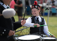 Max Carl, 10, practices with the Anchorage Scottish Pipe Band before competing in the Alaska Scottish Highland Games pipe band competition at the Palmer fairgrounds.