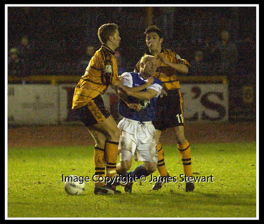 18/01/2003                   Copyright Pic : James Stewart.File Name : stewart-alloa v qots06.STEVE BOWEY IS BUNDLED OFF THE BALL BY STEVE THOMSON AND IAN LITTLE......James Stewart Photo Agency, 19 Carronlea Drive, Falkirk. FK2 8DN      Vat Reg No. 607 6932 25.Office     : +44 (0)1324 570906     .Mobile  : +44 (0)7721 416997.Fax         :  +44 (0)1324 570906.E-mail  :  jim@jspa.co.uk.If you require further information then contact Jim Stewart on any of the numbers above.........