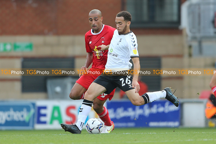 Faysal Bettache of Oldham Athletic and Darren Pratley of Leyton Orient during Leyton Orient vs Oldham Athletic, Sky Bet EFL League 2 Football at The Breyer Group Stadium on 11th September 2021
