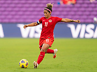 ORLANDO, FL - FEBRUARY 24: Desiree Scott #11 of Canada passes the ball during a game between Brazil and Canada at Exploria Stadium on February 24, 2021 in Orlando, Florida.