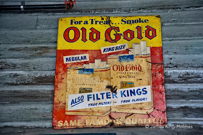 Old metal cigarette advertisement on the wooden wall of a North Carolina village store