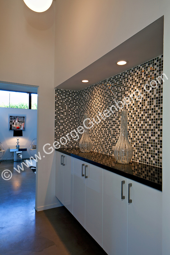Tiled and granite built-in storage cabinet in hallway