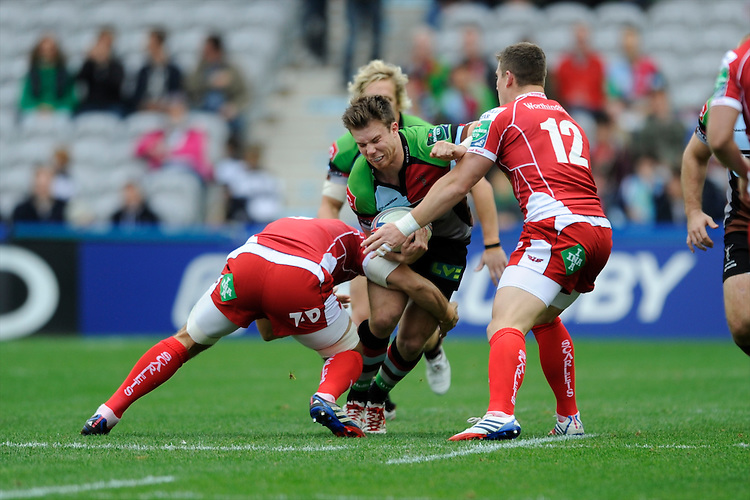 Sam Smith of Harlequins is tackled by Scott Williams of Scarlets during the Heineken Cup Round 1 match between Harlequins and Scarlets at the Twickenham Stoop on Saturday 12th October 2013 (Photo by Rob Munro)