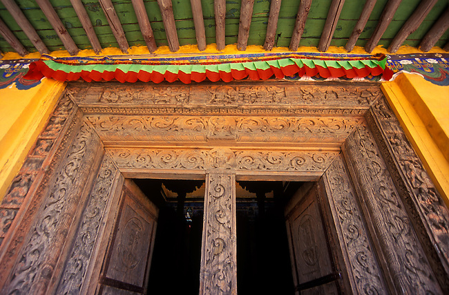 Carved DOORWAY of the LHAKANG KARPO or WHITE CHAPEL at TSAPARANG (10th C.), the lost city of the GUGE KINGDOM - TIBET
