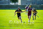Dr Croke's Brendan McMahon in possession as Causeway's Brendan Carroll puts in a challenge in the 2021 Junior Hurling Championship final