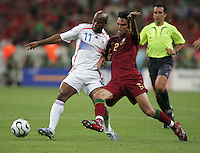 French forward (11) Sylvain Wiltord fights for the ball with Portuguese defender (2) Paulo Ferreira.  France defeated Portugal, 1-0, in their FIFA World Cup semifinal match at FIFA World Cup Stadium in Munich, Germany, July 5, 2006.