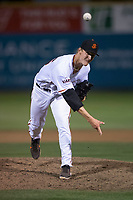 San Jose Giants relief pitcher Tyler Schimpf (46) follows through on his delivery during a California League game against the Modesto Nuts at San Jose Municipal Stadium on May 15, 2018 in San Jose, California. Modesto defeated San Jose 7-5. (Zachary Lucy/Four Seam Images)
