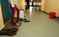 Shoes, Chechen children and laundry place on the corridor of the URiC Wola Refugee Centre in Poland..-For security reason, the face of the adult asylum seeker have been evicted of the photography..-For security reason, the names of the adult asylum seeker have been change. .-Article 9 of the Act of 13 June 2003 on grating protection on the Polish territory (Journal of Laws, No 128, it. 1176) personal data of refugees are an object of particular protection..-Cases where publication of a picture or name of asylum seeker had dramatic consequences for this persons and is family back in Chechnya. .Please have safety of those people in mind. Thank you.