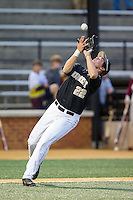 Wake Forest Demon Deacons third baseman Will Craig (22) catches a pop fly in the infield against the Florida State Seminoles at Wake Forest Baseball Park on April 19, 2014 in Winston-Salem, North Carolina.  The Seminoles defeated the Demon Deacons 4-3 in 13 innings.  (Brian Westerholt/Four Seam Images)