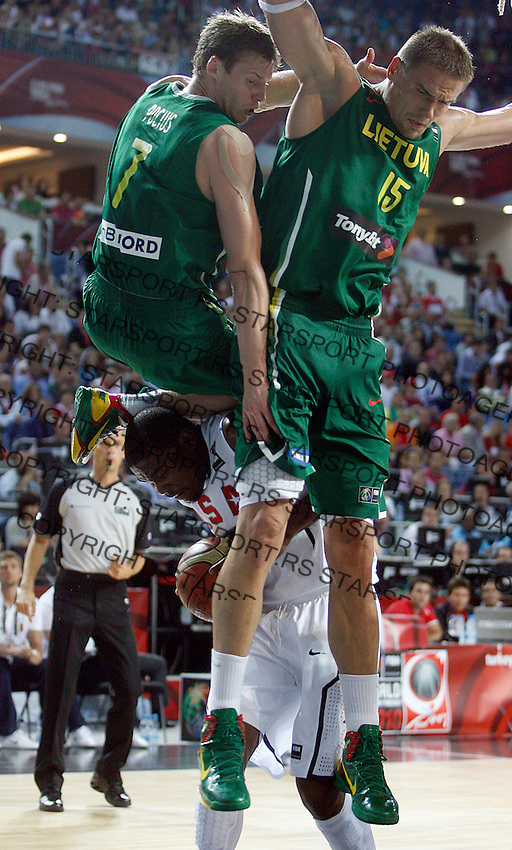 Martynas POCIUS (Lithuania) and Robertas JAVTOKAS (Lithuania) jumps over Kevin DURANT (USA) during the semi-final World championship basketball match against USA in Istanbul, USA-Lithuania, Turkey on Saturday, Sep. 11, 2010. (Novak Djurovic/Starsportphoto.com) .