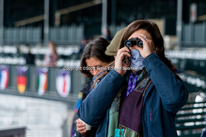 November 5, 2020: A woman watches racehorses participate in morning workouts at Keeneland Racetrack in Lexington, Kentucky on November 5, 2020. Scott Serio/Eclipse Sportswire/Breeders Cup/CSM