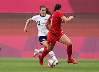 KASHIMA, JAPAN - AUGUST 2: Alex Morgan #13 of the USWNT dribbles during a game between Canada and USWNT at Kashima Soccer Stadium on August 2, 2021 in Kashima, Japan.