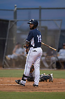 AZL Padres 2 right fielder Blinger Perez (14) steps into the batter's box during an Arizona League game against the AZL Padres 1 at Peoria Sports Complex on July 14, 2018 in Peoria, Arizona. The AZL Padres 1 defeated the AZL Padres 2 4-0. (Zachary Lucy/Four Seam Images)