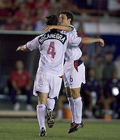 USA's Steve Cherundalo and Carlos Bocanegra celebrate after Bocanegra's goal against Panama in the first half in Panama City, Panama, Wednesday, June 8, 2005. USA won 3-0.