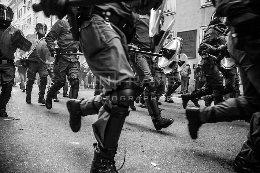 Riot police attempts to push  rioters out the red protected zone nearby the parliament building  where the  Lower House  voted the  confidence that resulted in a razor-thin victory for Berlusconi to continue his mandate. Rome, Italy. 14 Dec. 2010
