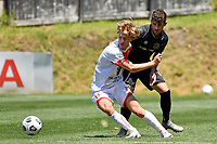 Alexander Greive of Waitakere United competes for the ball with Scott Midgley of Team Wellington during the ISPS Handa Men's Premiership - Team Wellington v Waitakere Utd at David Farrington Park,Wellington on Saturday 30 January 2021.<br /> Copyright photo: Masanori Udagawa /  www.photosport.nz