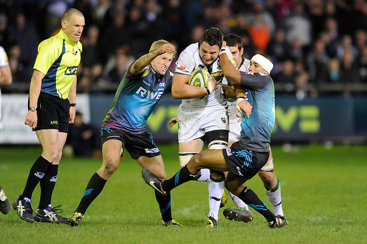 Phil Dowson of Northampton Saints forces his way through Eli Walker of Ospreys (right) during the LV= Cup second round match between Ospreys and Northampton Saints at Riverside Hardware Brewery Field, Bridgend (Photo by Rob Munro)
