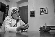 """Calcutta, India. April 04, 1975.<br /> Mother Teresa talking and listening to her staff  inside her Kalighat Home for the Dying in Calcutta. The first Home for the Dying opened in 1952 and was a free hospice for the poor. Mother Teresa (Agnes Gonxha Boyaxihu) the Roman Catholic, Albanian nun revered as India's """"Saint of the Slums,"""" was awarded the 1979 Nobel Peace Prize."""