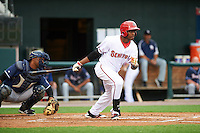 Harrisburg Senators right fielder Isaac Ballou (9) at bat in front of catcher Wilkin Castillo (14) during a game against the New Hampshire Fisher Cats on June 2, 2016 at FNB Field in Harrisburg, Pennsylvania.  New Hampshire defeated Harrisburg 2-1.  (Mike Janes/Four Seam Images)