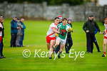 James O'Connor of Na Gaeil in possession as An Ghaeltacht's Brian O'Beaglaoich puts in a tackle in the Intermediate Club Football Championship