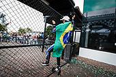 Winner #10: Konica Minolta Acura ARX-05 Acura DPi, DPi: Helio Castroneves climbs the fence as the fans cheer him on, podium