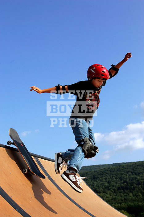 Skateboarder Harrison Christy, 11, of Easton, Connecticut, rides down the ramp at the Launch Pad at Camp Woodward in Woodward, Pennsylvania.  August 9, 2005.