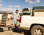 December 30, 2016. Rose Hill, North Carolina.<br /> <br /> John Dunn steps over the trailer hitch of a truck at Cottles Organics, a farm where he has worked since he was a child.<br />  <br /> John Dunn, age 19, is currently a freshman at NC State University and is the first person in his family to go to college. With a combination of grants, loans, help from his grandfather and weekend farm work, Dunn hopes to find finish college and find a career in agriculture.<br /> <br />  Colleges and universities, which are always trying to pinpoint an under-served and sometimes underprivileged populations of students, have noted a decline in students from rural areas of the country. There are various efforts underway in colleges and universities to identify more of these kids and get them enrolled.