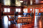 The tasting room at Stone Mountain Vineyards is beautifully paneled in warm wood tones, illuminated by windows showing a fabulous vista of the Shenandoah Valley.  (HDR image)