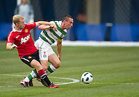 July 16, 2010 Paul Scholes No.18 of Manchester United and Scott Brown No. 8 of Celtic FC  during an international friendly between Manchester United and Celtic FC at the Rogers Centre in Toronto.