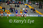 Lixnaws Jeremy McKenna attempts to get rid of the sliotar as Ronan Walsh of Kilmoyley tries to block his effort in round 2 of the County Senior hurling championship