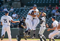 NWA Democrat-Gazette/BEN GOFF @NWABENGOFF<br /> Landry Jurecka (from left), Brandon Woolsey, Connor Noland, Jake Smith and Chance Sneathern of Greenwood celebrate after defeating Benton 4-0 Saturday, May 19, 2018, during the class 6A baseball state championship at Baum Stadium.