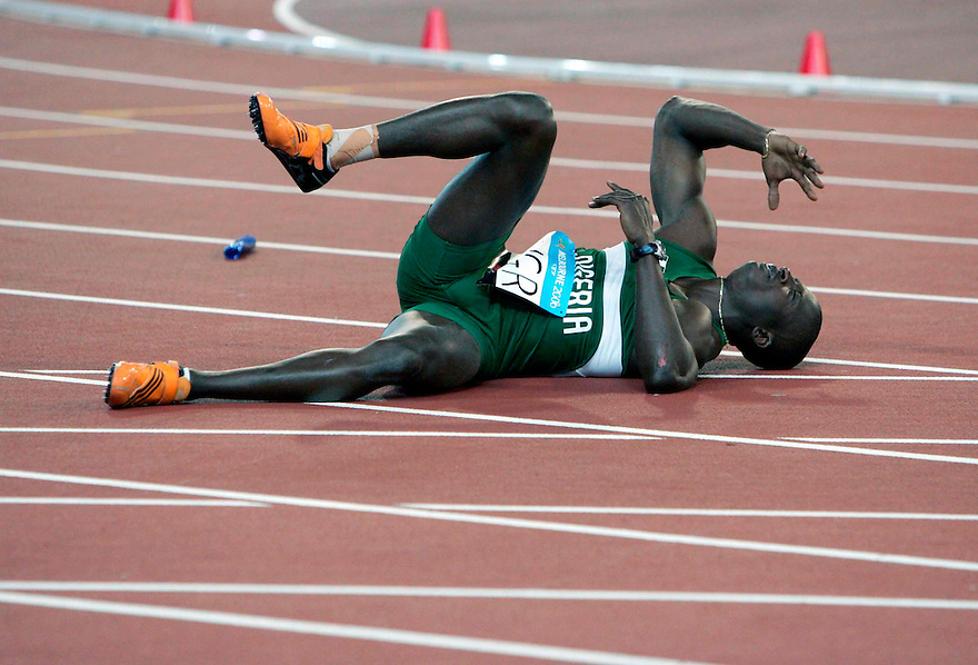 Athletics at the 2006 Melbourne Commonwealth Games. Nigeria's Uchenna Emedolu collapses after a mix up in the heats of the mens 4 x 100 relay.