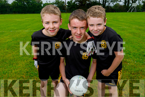 Twins Kevin and Aaron Brosnan with their brother Rory looking forward to activities on the field as Currow GAA reopen their field.