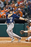 Michael Aquino #15 of the Rice Owls follows through on his swing against the Texas Longhorns at Minute Maid Park on February 28, 2014 in Houston, Texas.  The Longhorns defeated the Owls 2-0.  (Brian Westerholt/Four Seam Images)