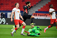 16th February 2021, Puskas Arena, Budapest, Hungary; Champions League football, FC Leipig versus Liverpool FC;  Mohamed Salah (M oben) of Liverpool shoots and scores for 0:1 past keeper Peter Gulacsi  of Leipzig and Nordi Mukiele Leipzig.