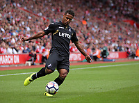 Wayne Routledge of Swansea City crosses the ball to team mate Tammy Abraham who headed the ball wide during the Premier League match between Southampton and Swansea City at the St Mary's Stadium, Southampton, England, UK. Saturday 12 August 2017