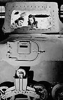 Two Young Women are here inspecting the equipment in a Ram tank before the gun shield is rivetted in place and the cannan installed. Designed by Maj. Gen. F. F. Worthington; O.C. 4th Canadian division; Rams are being supplied to two Canadian divisions. during World War, 1939-1945<br /> <br /> PHOTO : Toronto Star Archives - AQP