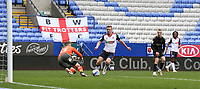 Oldham Athletic's goalkeeper Laurence Bilboe saves at the feet of Bolton Wanderers' Eoin Doyle<br /> <br /> Photographer Stephen White/CameraSport<br /> <br /> The EFL Sky Bet League Two - Bolton Wanderers v Oldham Athletic - Saturday 17th October 2020 - University of Bolton Stadium - Bolton<br /> <br /> World Copyright © 2020 CameraSport. All rights reserved. 43 Linden Ave. Countesthorpe. Leicester. England. LE8 5PG - Tel: +44 (0) 116 277 4147 - admin@camerasport.com - www.camerasport.com