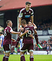 Hearts' Billy King is congratulated  after he scores their fourth goal.