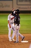 Missoula Osprey Cesar Garcia (8) celebrates after hitting a double during a Pioneer League game against the Great Falls Voyagers at Centene Stadium at Legion Park on August 19, 2019 in Great Falls, Montana. Missoula defeated Great Falls 1-0 in the second game of a doubleheader. (Zachary Lucy/Four Seam Images)