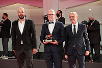 """VENICE, ITALY - SEPTEMBER 12: Davide Romani (C) poses with the Golden Lion for Best Film on behalf of US director Chloe Zhao for """"Nomadland"""" during the winners photocall at the 77th Venice Film Festival on September 12, 2020 in Venice, Italy. <br /> CAP/MPI/AF<br /> ©AF/MPI/Capital Pictures"""