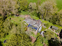 BNPS.co.uk (01202) 558833. <br /> Pic: Stags/BNPS<br /> <br /> Pictured: The property sits in 6.2-acres of gardens. <br /> <br /> Pictured: Station Halt was the station for Brampford Speke in Devon on the Exe Valley Railway line until it closed as part of the Beeching cuts in 1963.<br /> <br /> Just the ticket...<br /> <br /> A converted railway station with an old train carriage in the garden - on the market for offers over £550,000 - is the perfect home for train enthusiasts.<br /> <br /> Station Halt was the station for Brampford Speke in Devon on the Exe Valley Railway line until it closed as part of the Beeching cuts in 1963.<br /> <br /> The 136-year-old building was converted shortly after and is now a pretty three-bedroom bungalow with original features including the waiting room fireplace, ticket office window and the old train platform.<br /> <br /> There is even an old train carriage in the 6.2-acre gardens that could be converted and earn income as a holiday rental.