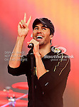 Enrique Iglesias performs during the halftime show during the Thanksgiving Day game between the Miami Dolphins and the Dallas Cowboys at the Cowboys Stadium in Arlington, Texas. Dallas defeats Miami 20 to 19...