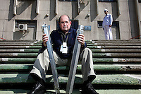 American-Ukrainian physicist Igor Bolshinsky holds two dummy fuel assemblies in front of the Institute of Nuclear Physics in Almaty .The removal of Kazakhstan's highly enriched uranium (HEU) is part of the U.S. Global Threat Reduction Initiative (GTRI), where Bolshinsky works, which tries to secure nuclear material around the world to prevent their misuse.