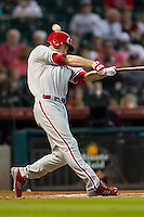 Philadelphia Phillies second baseman Chase Utley #26 fouls off a pitch during the Major League baseball game against the Houston Astros on September 16th, 2012 at Minute Maid Park in Houston, Texas. The Astros defeated the Phillies 7-6. (Andrew Woolley/Four Seam Images).
