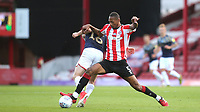 Ethan Pinnock of Brentford tackles Luke Thomas of Barnsley during Brentford vs Barnsley, Sky Bet EFL Championship Football at Griffin Park on 22nd July 2020