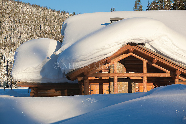 Deep snow covers the roof of the Visitor Center at Lolo Pass on the Idaho - Montana border